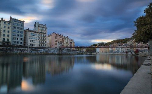 Cloudcover above the Saone river and Passerelle Saint-Vincent during sunset.