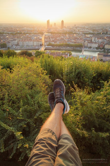 Legs of a man and the view from Fourviere.