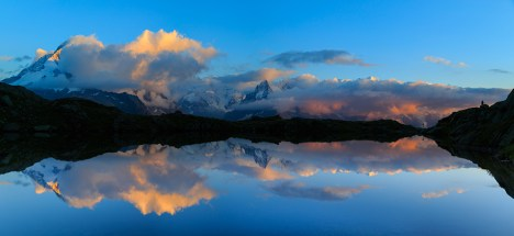 Mountains and clouds reflected in Lac De Cheserys.