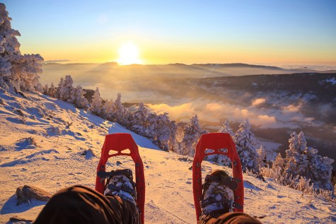 Looking over snowshoes at the beautiful sunset in the Vercors.