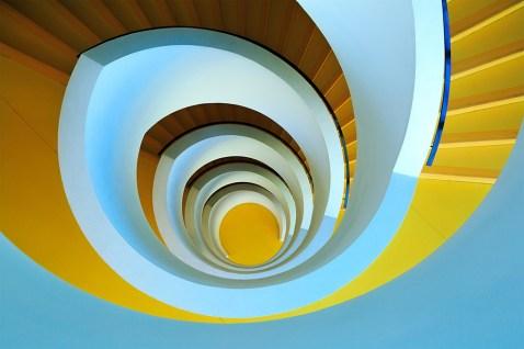 Yellow spiral staircase at Bibliothèque Universitaire de Chevreul in Lyon 2 Lumière.