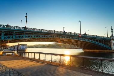 Bridge, Pont de l'Universite, over the Rhone river on a sunny afternoon.