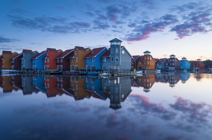Tranquil dawn at colorful wooden houses in the famous Reitdiephaven.