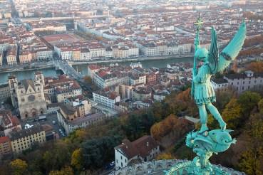 Statue of Saint Michel and the view over Lyon from basilique Notre-Dame de Fourvière.