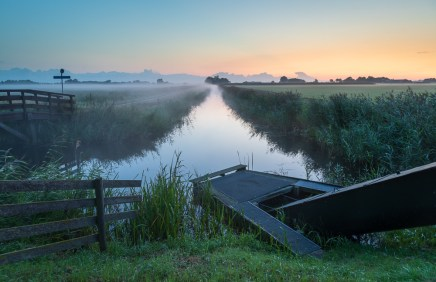 A small pumping station in the Dutch countryside on a foggy dawn. Groningen, Holland.