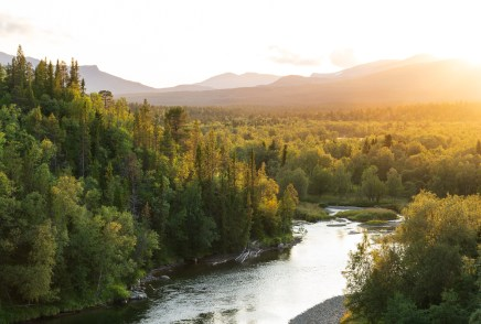 The sun setting over a river in a mountain wilderness. Jamtland.