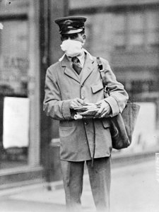 A postman wearing protective gauze. National Archives.