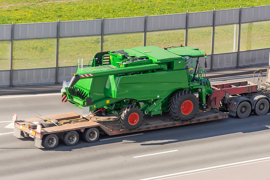 Combine on Truck - Harvest Season Causes Rise in Truck Accidents - Sand Law PLLC