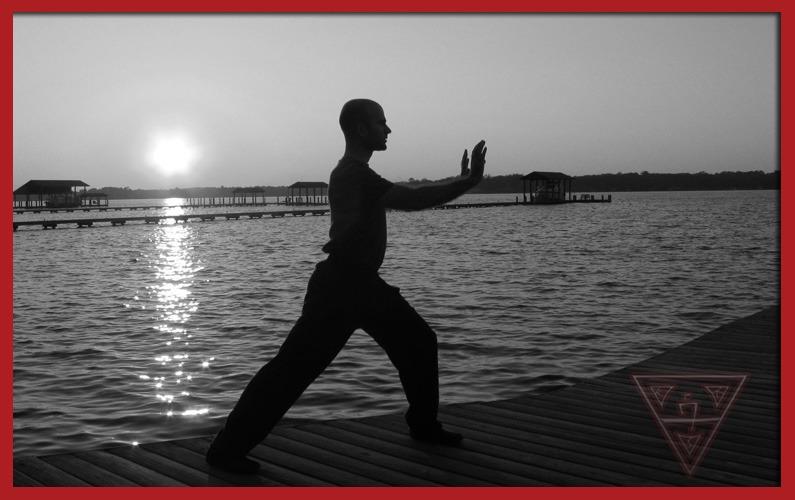 Man Practicing Martial Arts Balancing