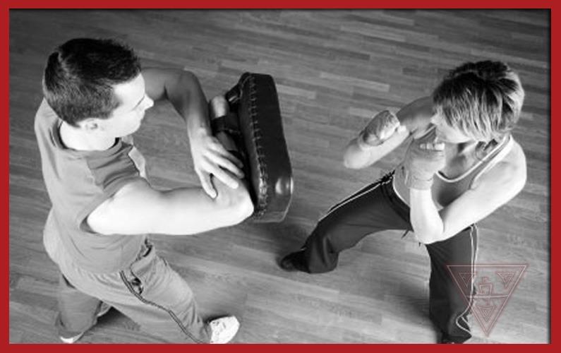 Man & Woman Practicing Kick Boxing
