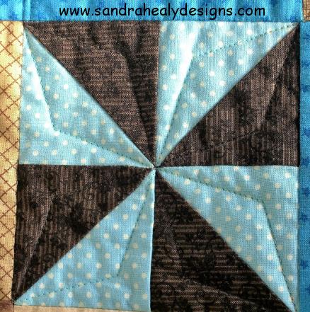 Alphabet quilt pinwheel block