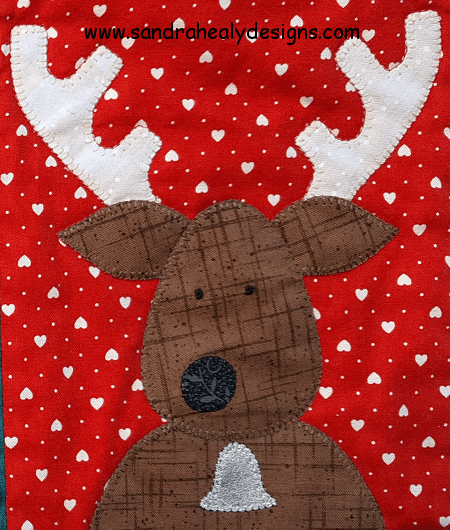 Sandra Healy Designs The Reindeer Crew Christmas quilt pattern reindeer closeup with bell