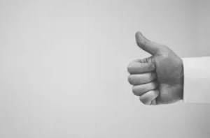 hand showing a thumbs up