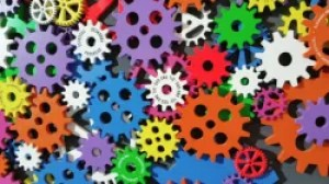Colourful cogs of different sizes