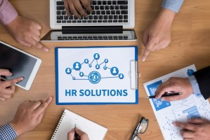 HR solutions written in a piece of paper