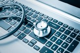 Stethoscope Over a Laptop Keyboard