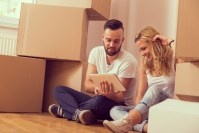 a man and a woman moving in a new flat