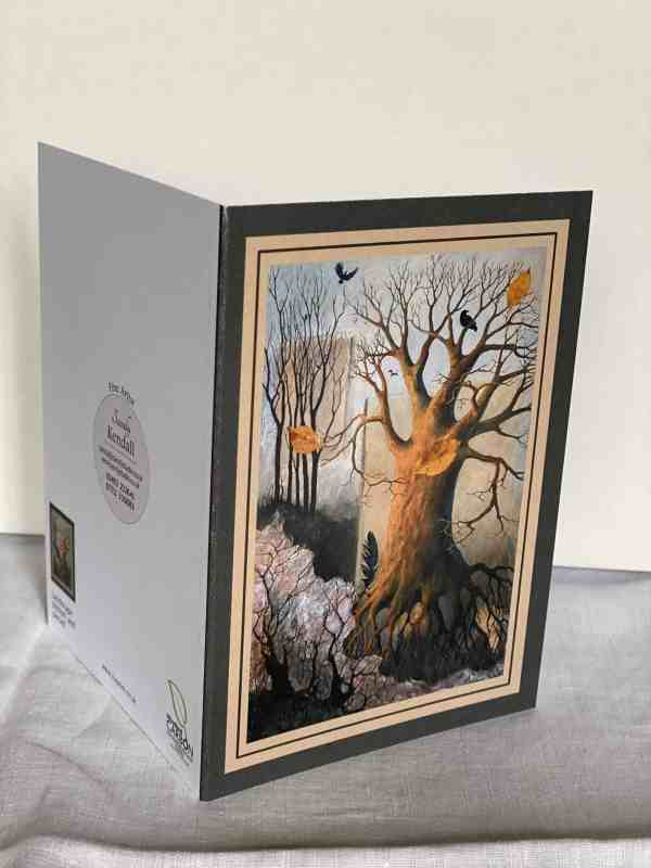 Photo of 'Landscape Plotted and Pieced' greetings card open on surface