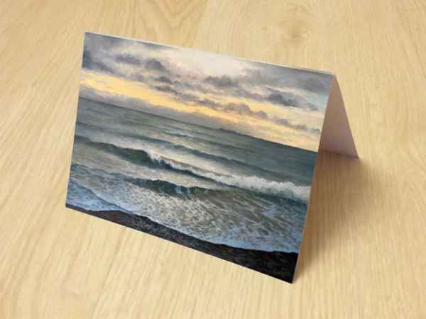 """photo of """"Light on water"""" greetings card open on surface"""