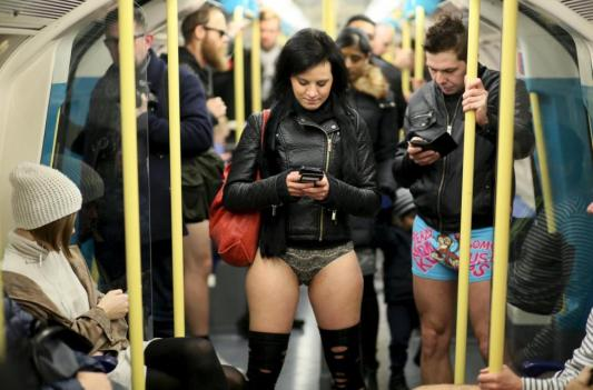 Participants in the annual No Trousers On The Tube Day ride the London Underground in London, Britain January 10, 2016.   REUTERS/Paul Hackett