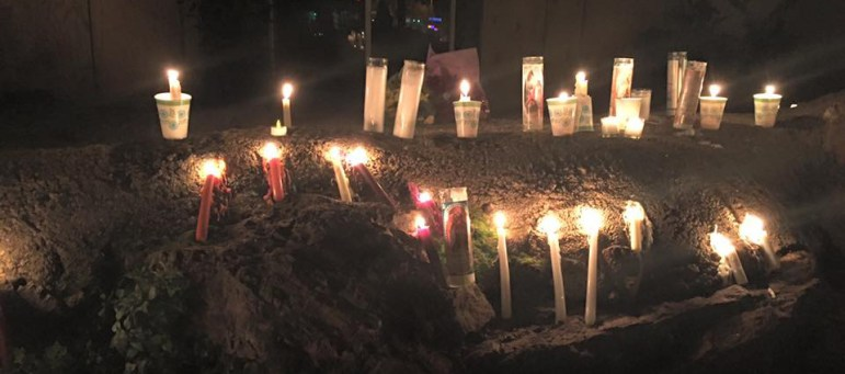 People lit candles by GP Sports, where Kyle Myrick worked and the last place he was seen alive. (Image via Facebook)