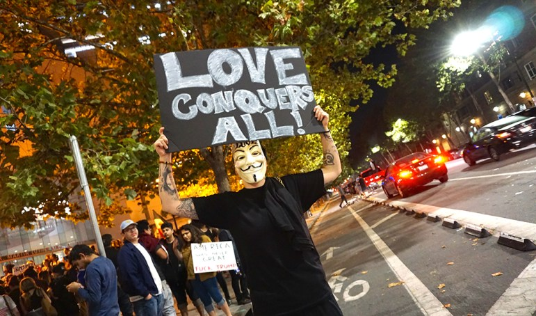 A protester outside the Martin Luther King Jr. Library in downtown San Jose. (Photo by Jennifer Wadsworth)