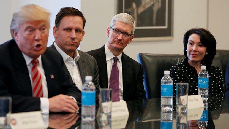 President-elect Donald Trump speaks as PayPal co-founder and Facebook board member Peter Thiel, Apple Inc CEO Tim Cook and Oracle CEO Safra Catz look on during a meeting with technology leaders at Trump Tower. (Photo by Shannon Stapleton, via Reuters)