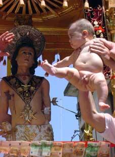 offerta dei bambini al santo