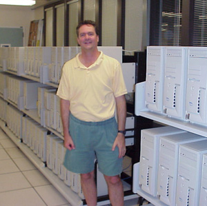 Haussler with the original Dell computer cluster used for the assembly of the first human genome. Contributed.