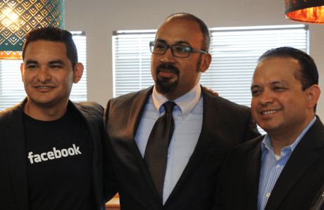 Juan Salazar, Facebook associate manager of state political outreach, Jacob Martinez, Digital NEST executive director, and Luis Alejo, California State Assemblyman shared a smile before the press conference announcing Facebook's donation of 25 new computers to multimedia training center Digital NEST. (Credit: Jan Janes)