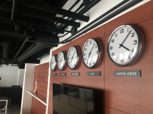 Clocks show the time in each location where HZ has an office. (Credit: Ted Holladay)