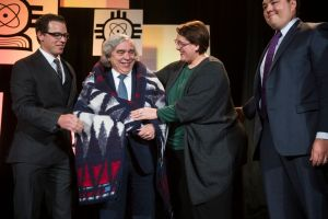 From left to right: Dr. Allyn Kaufmann a scientist at Proctor & Gamble, Inc., Secretary of Energy Ernest Moniz, Dr. Ahna Skop, associate professor at University of Wisconsin Madison, and Austin Shelton, doctoral candidate at University of Hawaii. SACNAS Board members present Dr. Ernest Moniz, U.S. Secretary of Energy with a Pendleton blanket during a traditional Native American honor ceremony. Secretary Moniz presented a keynote address to the SACNAS audience. Contributed.