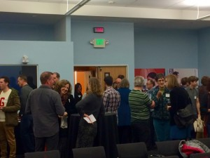 Attendees and panelists schmooze before the event. (Credit: Hilary Bryant)