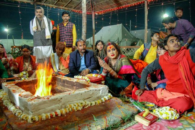 hijra - Tripathi and her followers prepare for homa, or havan, a Vedic votive ritual in which symbolic offerings are placed into a consecrated fire.