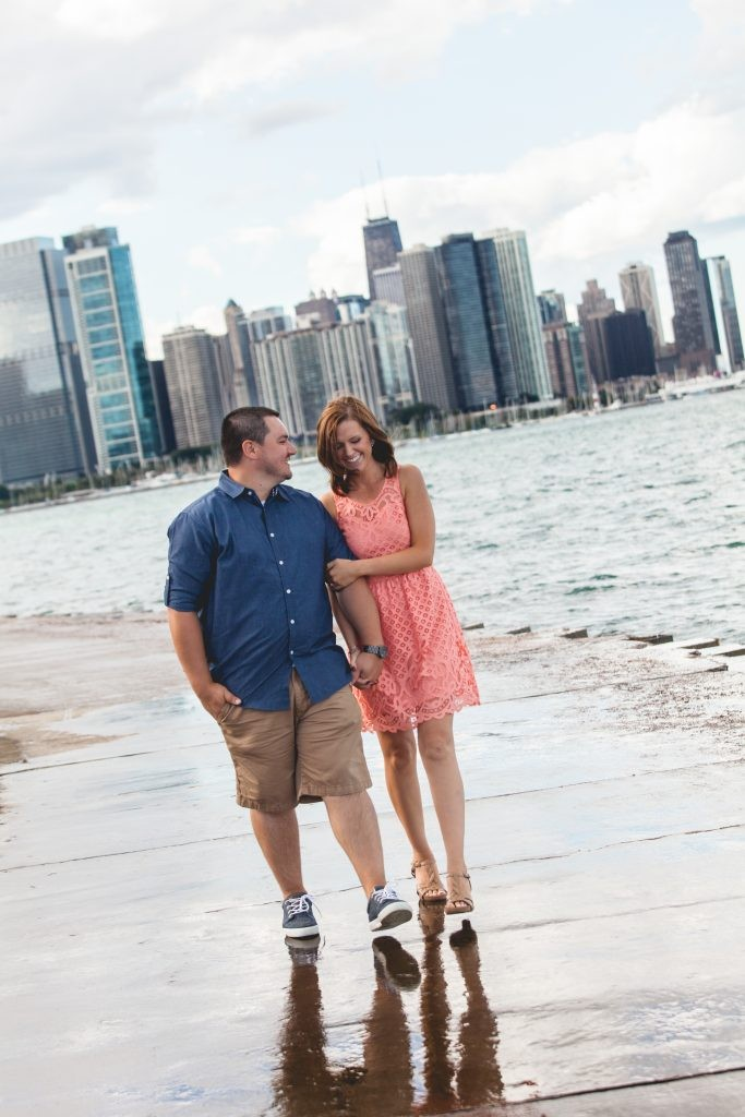 Chicago, Illinois Engagement session on Lake Michigan with a background of the city skyscrapers photography by Sara Anne Johnson