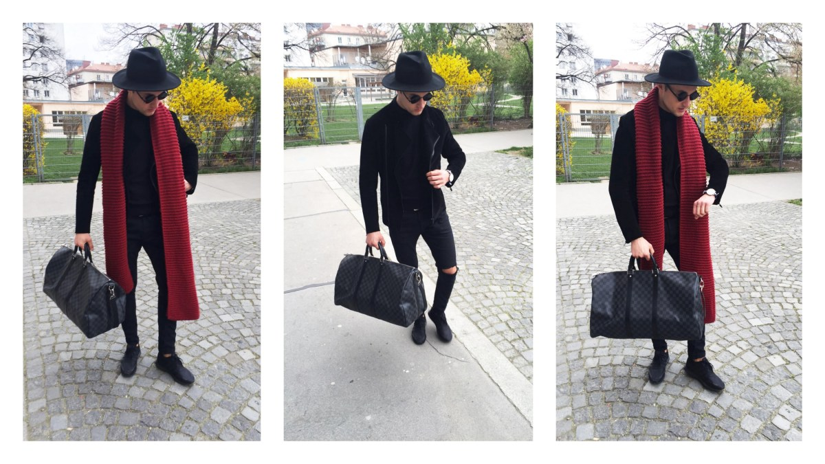 fashion and lifestyle blogger Ivo is showing his all black look with a red detail. A big red scarf.