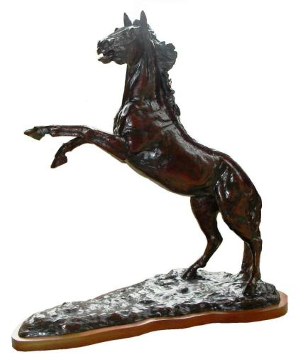 High & Mighty - a photo of a bronze sculpture of a rearing horse at 45 degrees
