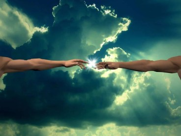 Arms reaching to each in front of the sun peeking through clouds to represent our connection to God and the energy of Angel Number 0