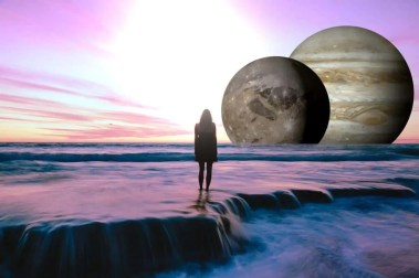 Woman standing in the sea looking at a bright light of God and large planets. Representing Angel Number 0 meaning you being pulled closer to God and the Universe
