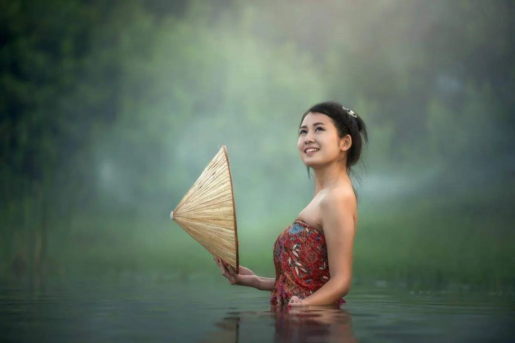 A woman standing in water. In order to manifest your intentions live for yourself without fear of judgement.