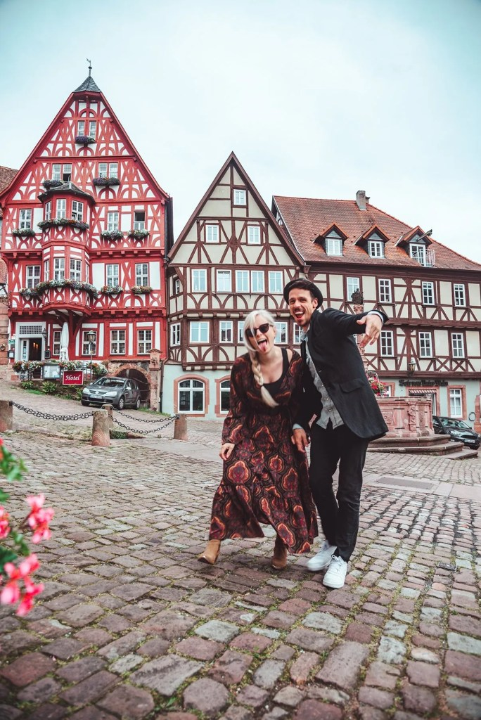 Couple taking pictures on market square in Miltenberg Germany