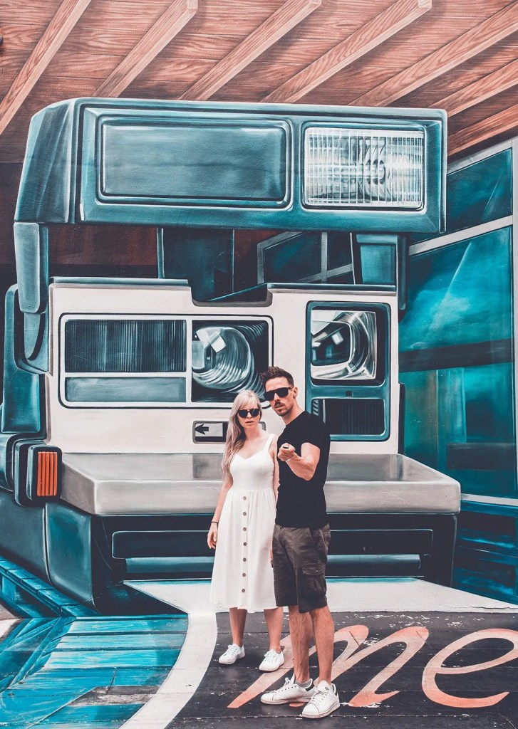 couple in front of Wynwood walls