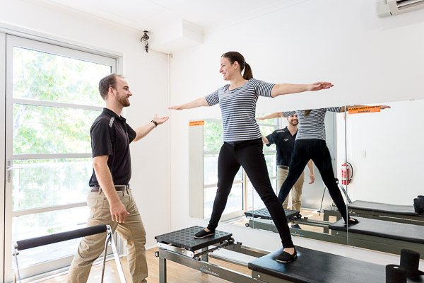 Overcoming Overwhelm: The Power of Happiness Course Review - Laura trying out pilates at PhysioWest.