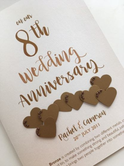 with bronze effect card hearts