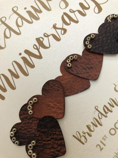 the hearts are decorated with tiny gold colour beads
