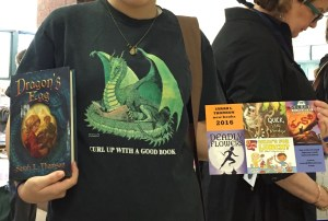 This reader didn't want her face to show in the photo. But how cool is it to meet a reader whose shirt matches your book!