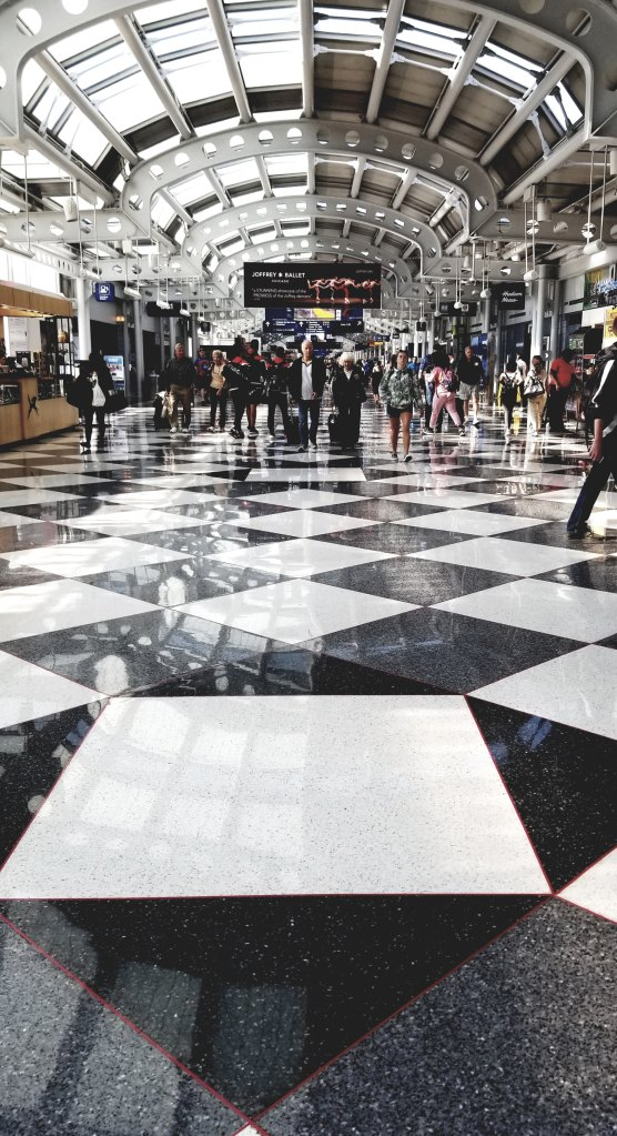 white and black floor tiles close-up photography at Chicago O'Hare