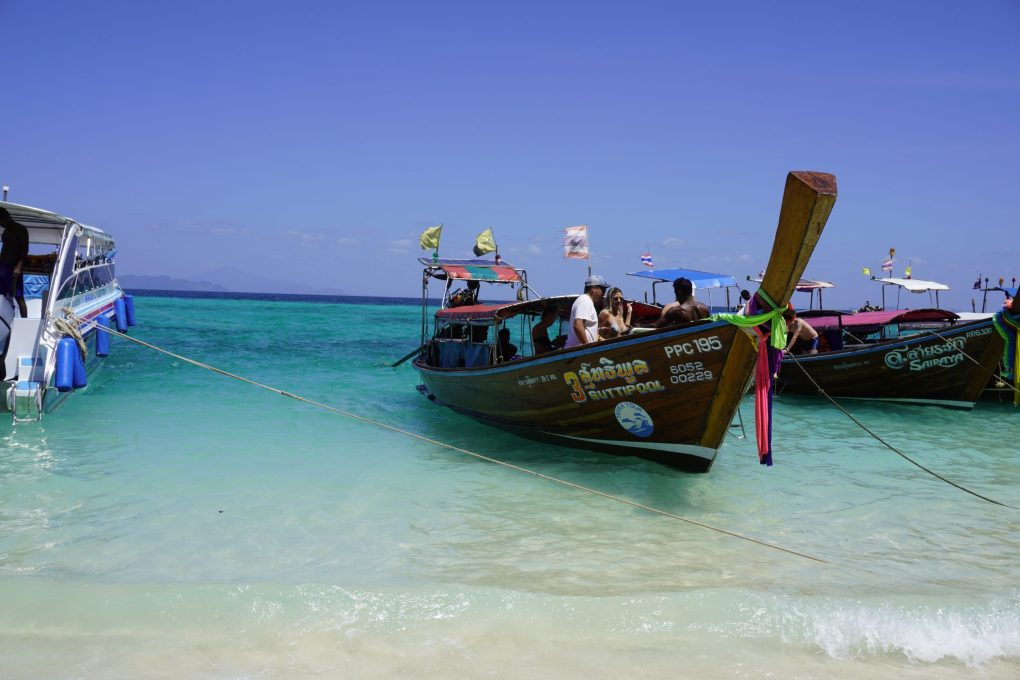 taxi longboats anchored on Bamboo Island, Phi Phi Islands, Thailand