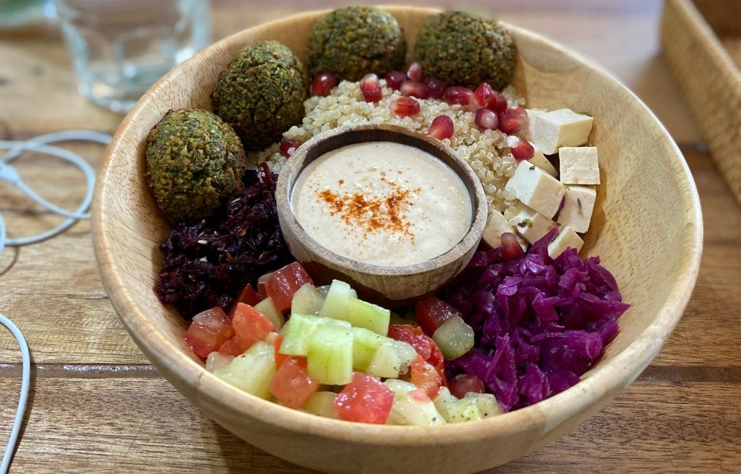 wooden bowl with falafel and vegetables
