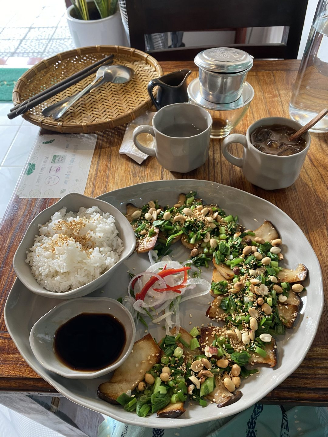 grey plate with mushrooms, peanuts, green onion, and rice
